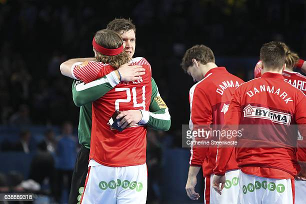 Mikkel Hansen of Denmark congratulates Niklas Landin Jacobsen of Denmark best player of the 25th IHF Men's World Championship 2017 match between...