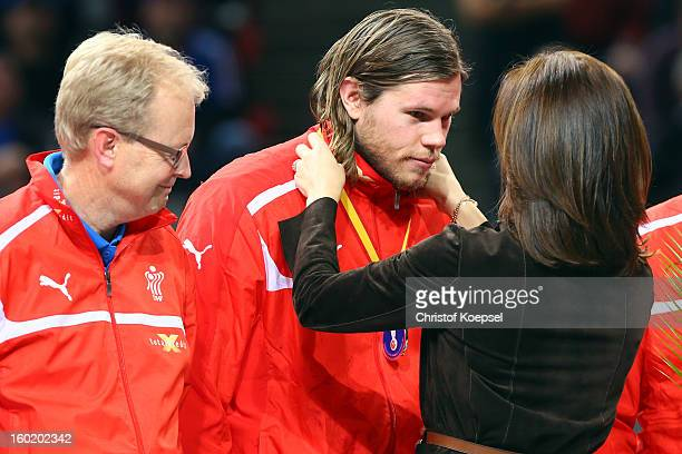 Mikkel Hansen of Denmark gets the silver medal of Crown Princess Mary of Denmark on the podium after the Men's Handball World Championship 2013 final...