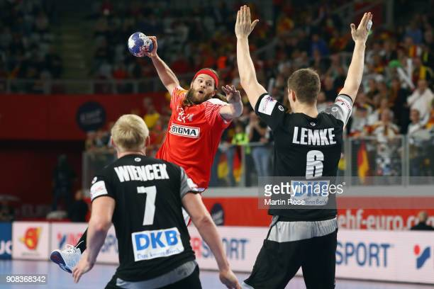 Mikkel Hansen of Denmark is challenged by Finn Lemke and Patrick Wiencek of Germany during the Men's Handball European Championship main round group...