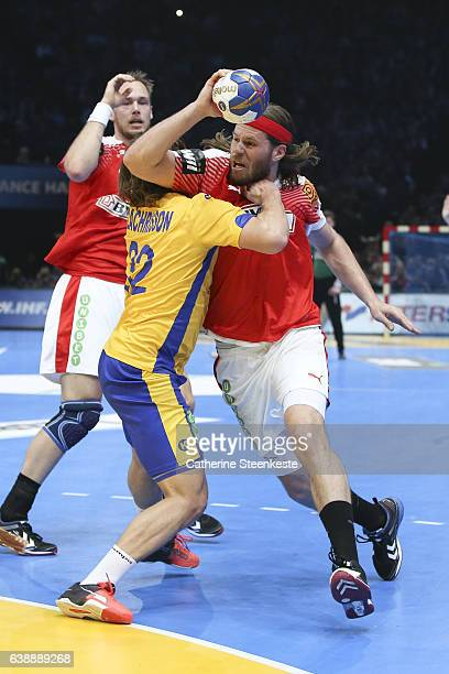 Mikkel Hansen of Denmark is trying to shoot the ball against Mathias Zachrisson of Sweden during the 25th IHF Men's World Championship 2017 match...