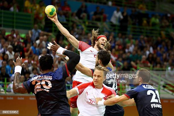 Mikkel Hansen of Denmark jumps to take a shot during the Men's Gold Medal Match between Denmark and France on Day 16 of the Rio 2016 Olympic Games at...