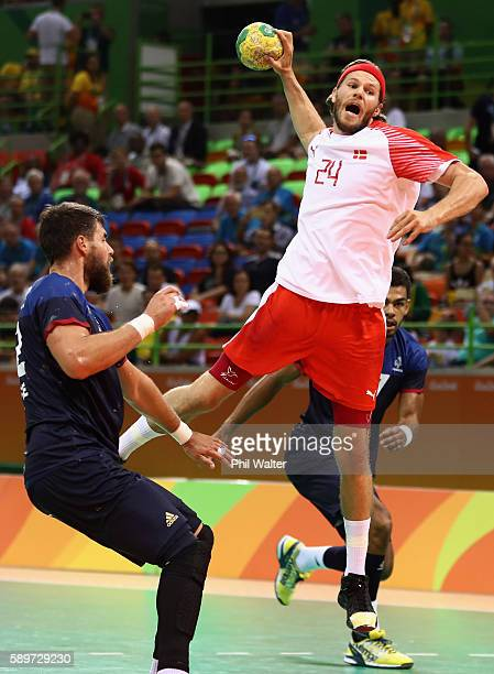Mikkel Hansen of Denmark jumps to take a shot during the Men's Preliminary Group A match between France and Denmark on Day 10 of the Rio 2016 Olympic...