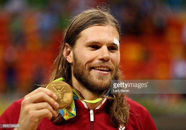 Mikkel Hansen of Denmark poses with his gold medal during the medal ceremony for Men's Handball on Day 16 of the Rio 2016 Olympic Games at Future...