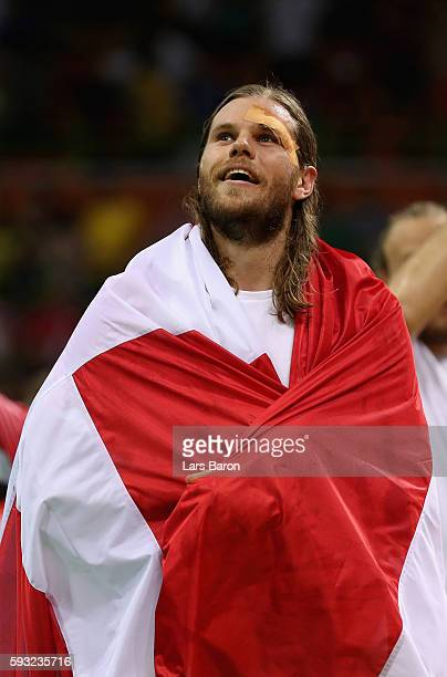 Mikkel Hansen of Denmark reacts after defeating France 2826 to win the gold medal in Men's Handball on Day 16 of the Rio 2016 Olympic Games at Future...