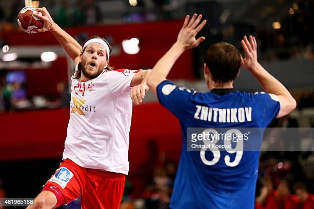 Mikkel Hansen of Denmark shoots over Dmitry Zhitnikov of Russia during the IHF Men's Handball World Championship group D match between Russia and...