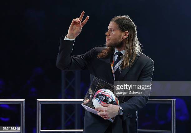 Mikkel Hansen of Paris lifts his hand after receiving the trophy a top scorer of the season after the the EHF Champions League Final on May 29 2016...