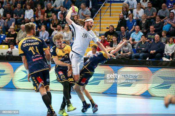 Mikkel Hansen of Paris Saint Germain is shooting the ball against Jan Stehlic and Arthur Vigneron of SaintRaphael Var Handball during the semifinal...