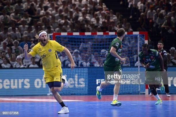Mikkel Hansen of Paris SaintGermain reacts after scoring during the Handball French Cup Final match between Nimes and Paris Saint Germain at...
