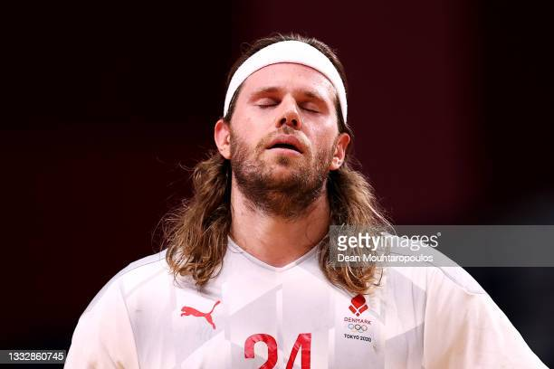 Mikkel Hansen of Team Denmark looks dejected after being defeated by Team France in the Men's Gold Medal Match on on day fifteen of the Tokyo 2020...