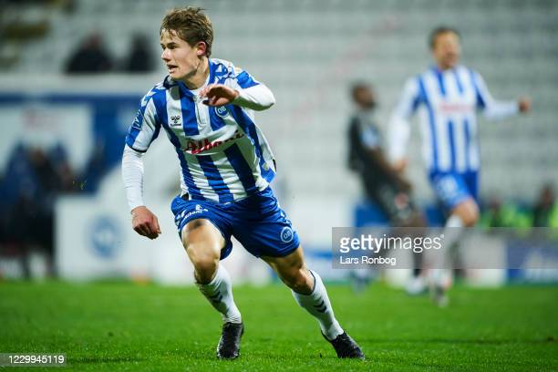 Mikkel Hyllegaard of OB Odense celebrates after scoring their second goal during the Danish 3F Superliga match between OB Odense and AaB Aalborg at...
