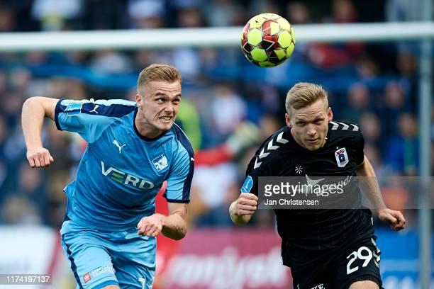 Mikkel Kallesoe of Randers FC and Bror Blume of AGF Arhus compete for the ball during the Danish 3F Superliga match between Randers FC and AGF Arhus...