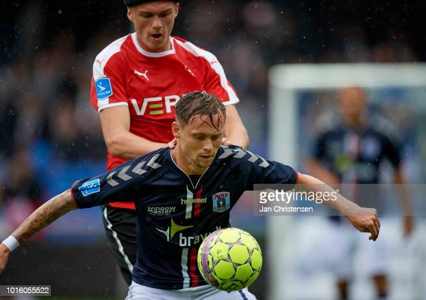 Mikkel Kallesoe of Randers FC and Jakob Ankersen of AGF Arhus compete for the ball during the Danish Superliga match between Randers FC and AGF Arhus...