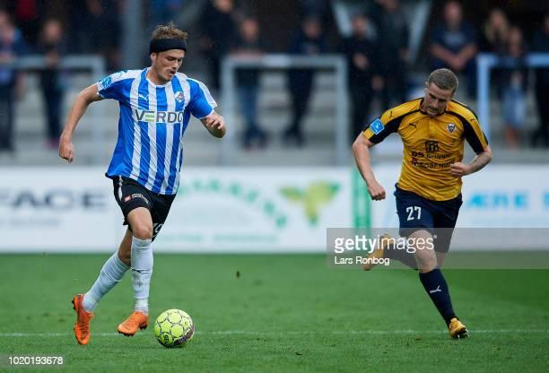 Mikkel Kallesoe of Randers FC and Mathias Haarup of Hobro IK compete for the ball during the Danish Superliga match between Randers FC and Hobro IK...
