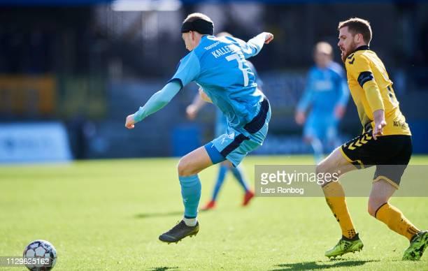 RANDERS DENMARK MARCH Mikkel Kallesoe of Randers FC and Mathias Nielsen of AC Horsens compete for the ball during the Danish Superliga match between...