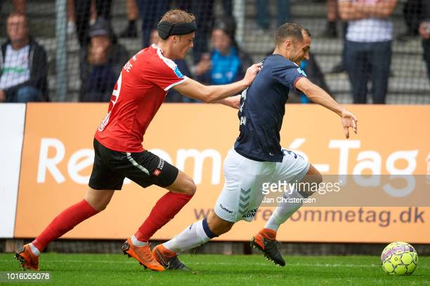 Mikkel Kallesoe of Randers FC and Niklas Backman of AGF Arhus compete for the ball during the Danish Superliga match between Randers FC and AGF Arhus...