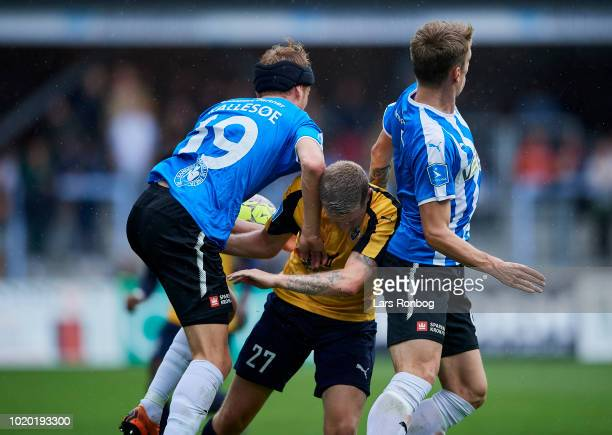 Mikkel Kallesoe of Randers FC Mathias Haarup of Hobro IK and Andre Romer of Randers FC compete for the ball during the Danish Superliga match between...