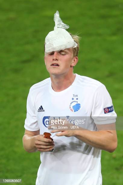 Mikkel Kaufmann of FC Kobenhavn cools down as the game heads to extra time during the UEFA Europa League Quarter Final between Manchester United and...