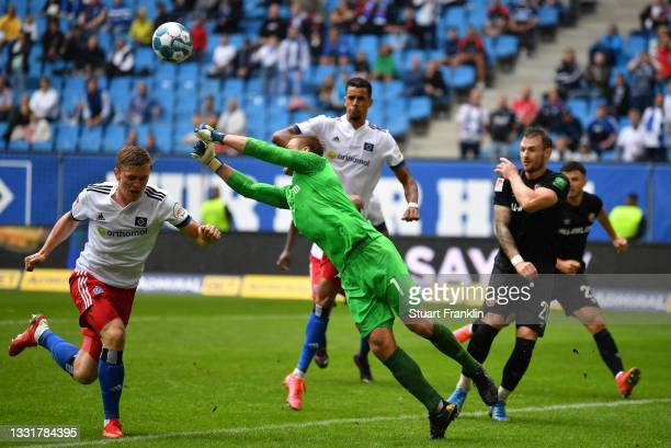 Mikkel Kaufmann of Hamburg has a shot saved by Kevin Broll of Dresden during the Second Bundesliga match between Hamburger SV and SG Dynamo Dresden...