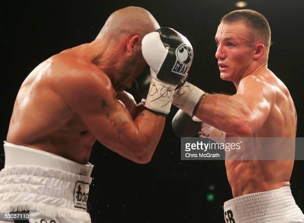 Mikkel Kessler of Denmark lands a punch on Anthony Mundine of Australia during the WBA super middleweight title fight between Anthony Mundine of...
