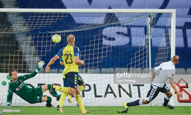 Mikkel Rask of AGF Aarhus scores the 20 goal against Goalkeeper Frederik Ronnow of Brondby IF during the Danish Alka Superliga match between AGF...
