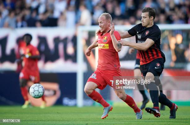 Mikkel Rygaard of FC Nordsjalland and Erik Sviatchenko of FC Midtjylland compete for the ball during the Danish Alka Superliga match between FC...