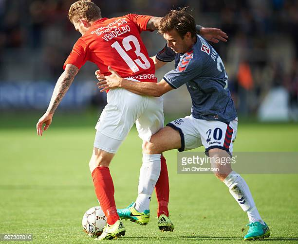 Mikkel Vendelbo of Silkeborg IF and Elmar Bjarnason of AGF Arhus compete for the ball during the Danish Alka Superliga match between Silkeborg IF and...