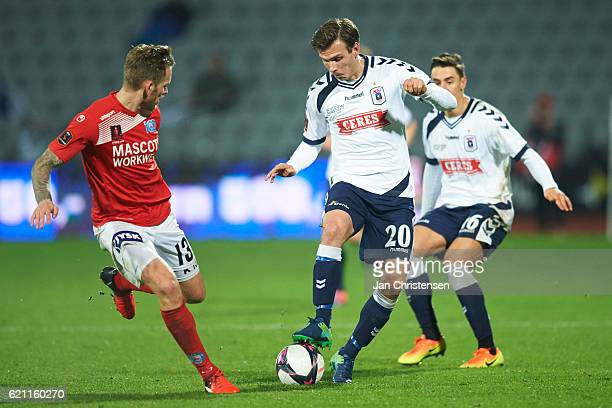 Mikkel Vendelbo of Silkeborg IF and Elmar Bjarnason of AGF Arhus compete for the ball during the Danish Alka Superliga match between AGF Arhus and...