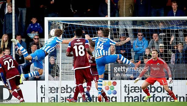 Mikkel Vestergaard of Esbjerg fB scores the 12 goal on a header against Goalkeeper Stephan Andersen of FC Copenhagen during the Danish Alka Superliga...