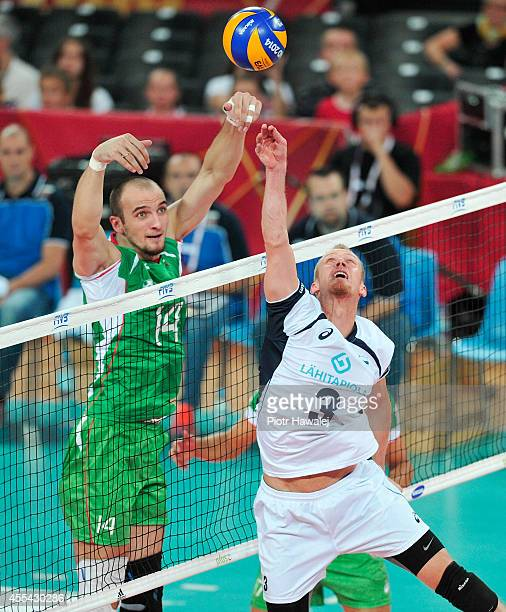 Mikko Esko of Finland sets up as Teodor Todorov of Bulgaria blocks during the FIVB World Championships match between Finland and Bulgaria on...