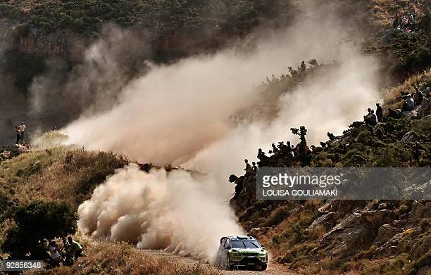 Mikko Hirvonen and Jarmo Lehtinen drive their Ford Focus RS at KleniaMycenae special stage on day two of the WRC Rally Acropolis near the village of...