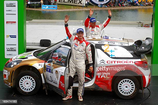 Mikko Hirvonen and Jarmo Lehtinen of Finland celebrate second place during day three of FIA World Rally Championship Mexico on March 10 2013 in Leon...