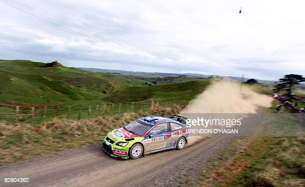 Mikko Hirvonen of Finland and codriver Jarmo Lehtinen of Finland in their BP world Abu Dhabi Rally team Ford Focus Rs during day two of the WRC Rally...