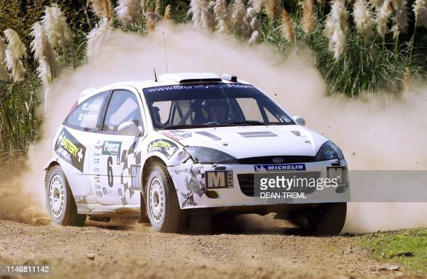Mikko Hirvonen of Finland and his codriver Jarmo Lehtine of Finland in their Ford Focus RS blast through special stage 20 on their way to an overall...