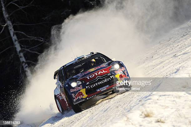 Mikko Hirvonen of Finland and Jarmo Lehtinen of Finland compete in their Citroen Total WRT Citroen DS3 WRC during Day 3 of the WRC Rally Sweden on...
