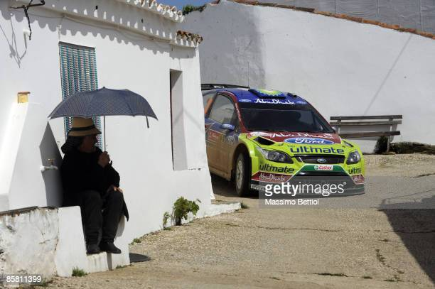 Mikko Hirvonen of Finland and Jarmo Lehtinen of Finland compete in their Abu Dhabi Ford Focus during Leg 3 of the WRC Vodafone Rally Portugal on...