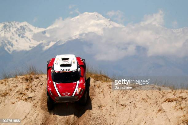 Mikko Hirvonen of Finland and Mini XRaid drives with codriver Andreas Schulz of Germany in the Mini John Cooper Works Buggy car in the Classe T14 2...