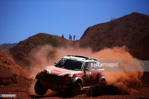 Mikko Hirvonen of Finland and Mini XRaid drives with codriver Michel Perin of France in the John Cooper Works Rally Mini car in the Classe T12 4x4...