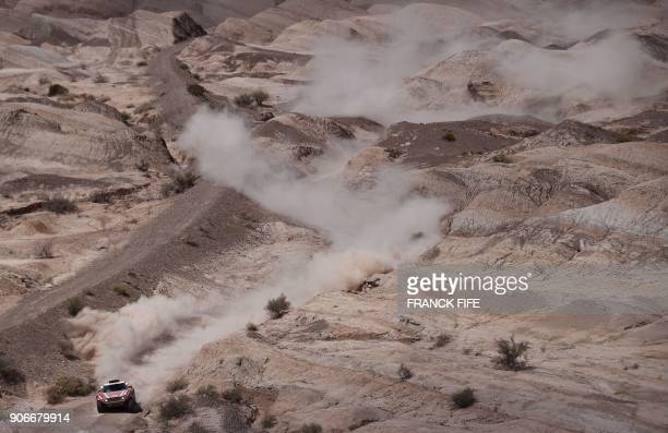 Mikko Hirvonen of Finland with his codriver Andreas Schulz of Germany steers his Mini during Stage 12 of the 2018 Dakar Rally between Chilecito and...