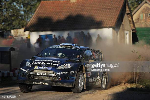 Mikko Hirvonen of Finlnd and Jarmo Lehtinen of Finland compete in their MSport WRT Ford Fiesta RS WRC during Day One of the WRC Poland on June 27...