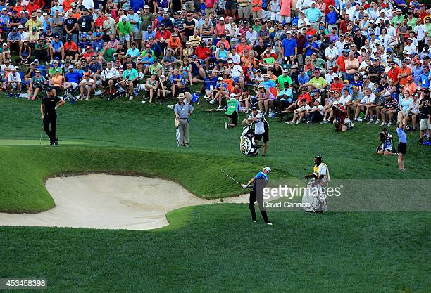 Mikko Ilonen of Finland hits his third shot on the 12th hole during the final round of the 96th PGA Championship at Valhalla Golf Club on August 10,...