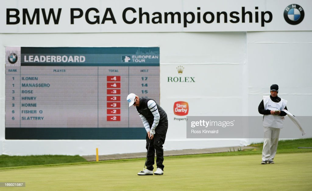 Mikko Ilonen of Finland holes out on the 18th green during the first round of the BMW PGA Championship on the West Course at Wentworth on May 23, 2013 in Virginia Water, England.