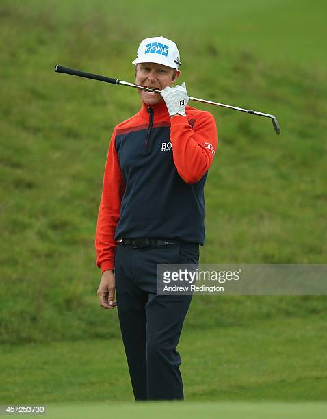 Mikko Ilonen of Finland reacts after his chip shot on the 18th hole during the first round matches of the Volvo World Match Play Championship at The...