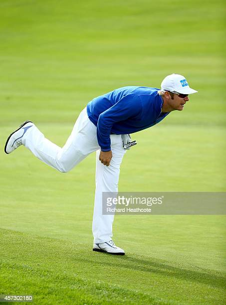 Mikko Ilonen of Finland reacts to a putt on the 6th green during his first round match against Graeme McDowell of Northern Ireland at the Volvo World...