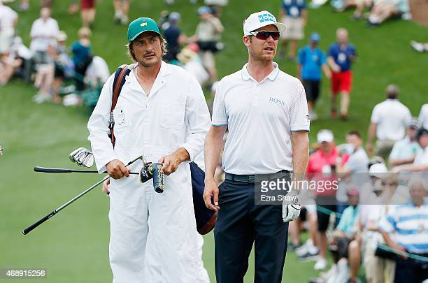 Mikko Ilonen of Finland waits on a green with his caddie fromer NHL player Teemu Selanne during the Par 3 Contest prior to the start of the 2015...