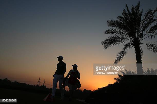 Mikko Ilonen of Finland walks with his caddie during the second round of the Abu Dhabi HSBC Golf Championship at the Abu Dhabi Golf Club on January...