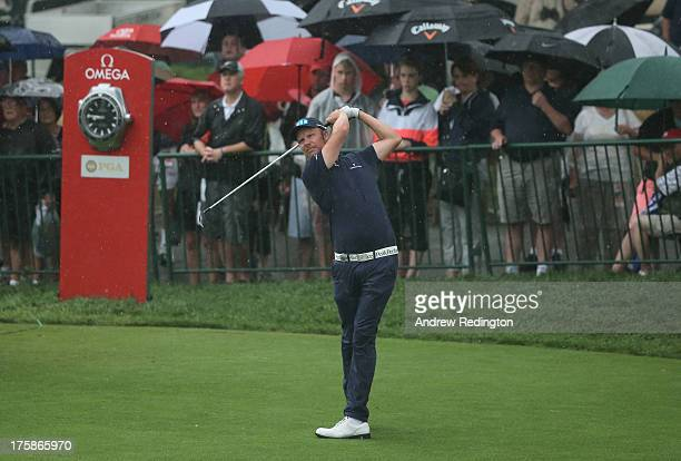 Mikko Ilonen of Finland watches his tee shot on the first hole during the second round of the 95th PGA Championship on August 9 2013 in Rochester New...