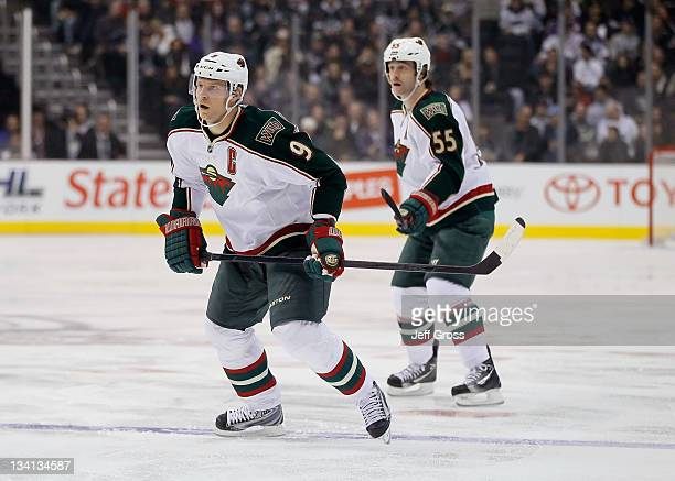 Mikko Koivu and Nick Schultz of the Minnesota Wild skate against the Los Angeles Kings at Staples Center on November 12, 2011 in Los Angeles,...