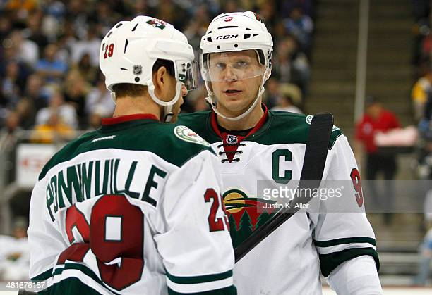 Mikko Koivu and Jason Pominville of the Minnesota Wild talk against the Pittsburgh Penguins during the game at Consol Energy Center on December 19,...