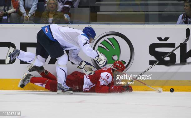 Mikko Koivu of Finland and Kirill Starkov of Denmark battle for the puck during the IIHF World Championship group D match between Finland and Denmark...