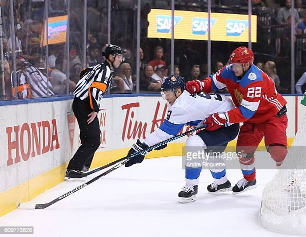 Mikko Koivu of Team Finland pulls the puck away from Nikita Zaitsev of Team Russia during the World Cup of Hockey 2016 at Air Canada Centre on...